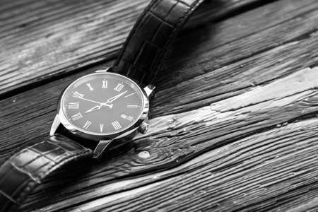 expensive: Expensive wrist watch on wooden surface