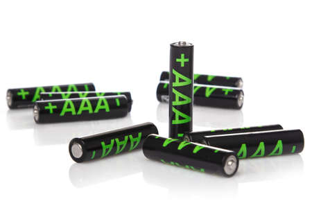 aaa: Heap of AAA batteries on white background