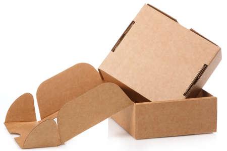 Small cardboard boxes on white background Foto de archivo