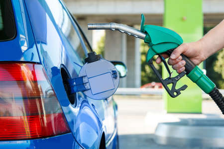 fueling: Man refuel his car on gas station Stock Photo
