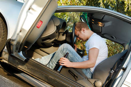 Drunk guy sleeping in the car Stock Photo