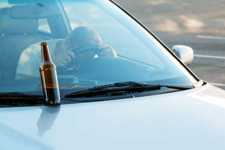 intoxication: Drunk guy sleeping in the car Stock Photo