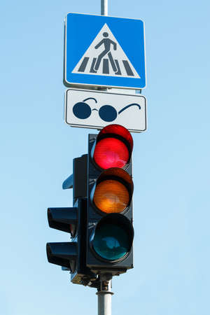 blind people: Traffic light for blind people over blue sky Stock Photo