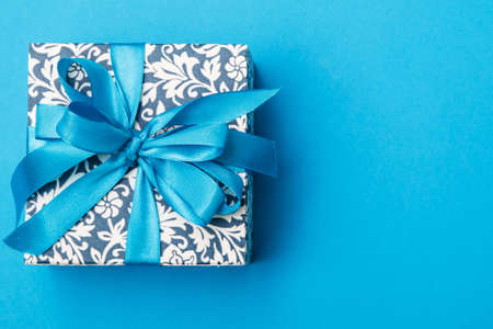 Blue gift box on light blue background