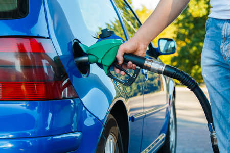 Man refuel his car on gas station Stock Photo