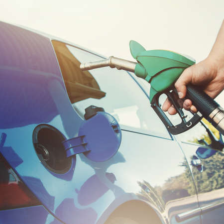 refuel: Man refuel his car on gas station Stock Photo