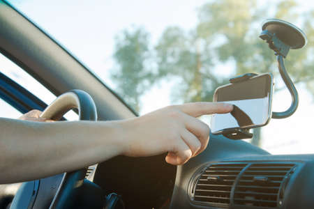 Male hand and smartphone in a car Stock Photo - 46046802