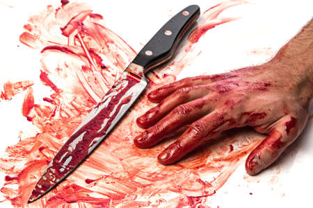 carnage: Male hand with bloody knife on white background Stock Photo