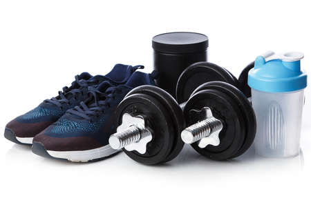 shaker: Dumbells, sneakers and shaker on whtie background Stock Photo