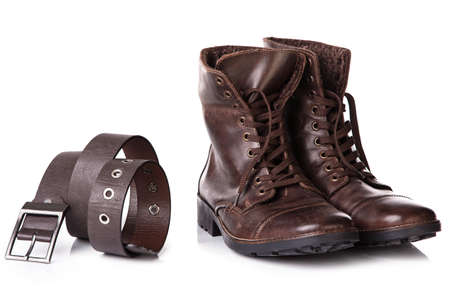 leather boots: Pair of leather boots and belt Stock Photo