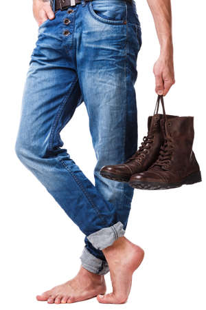 shoeless: Male legs and leather boots on white background