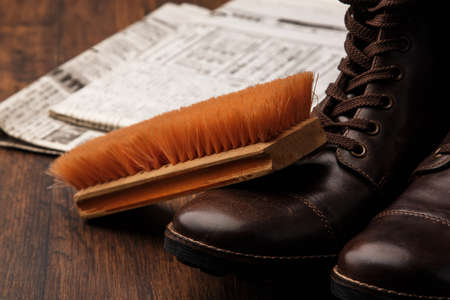 leather boots: Cleaning brush and leather boots Stock Photo