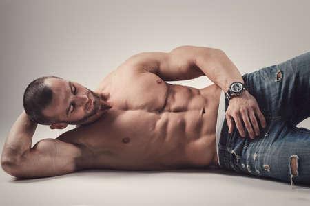 Handsome muscular man posing in studio Stock Photo