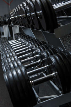 kilos: Various dumbbells in gym Stock Photo