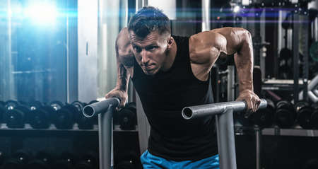 area sexy: Young muscular man during workout in the gym