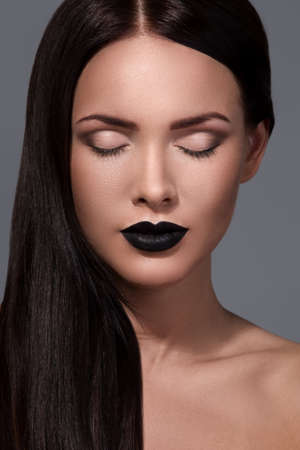 pomatum: Beautiful woman with straight hair and black lips