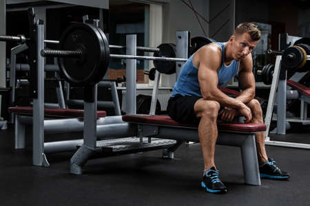 Man during bench press exercise in gym