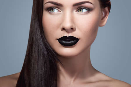 Portrait of beautiful woman with black lipstick