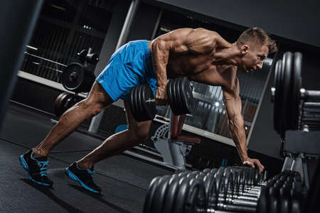 Man doing one-arm row exercise for his back