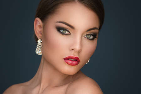 Portrait of gorgeous woman with luxury earrings