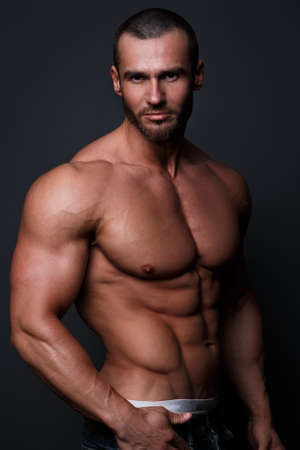 young male model: Handsome muscular man posing in studio Stock Photo