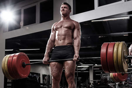 Strong man doing deadlift  in gym