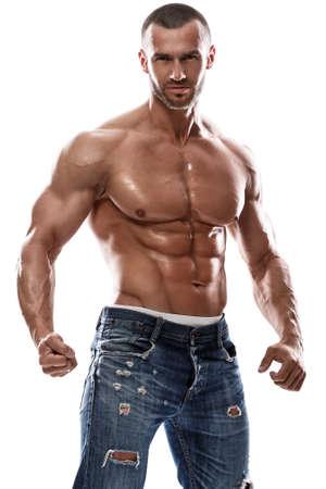 Hombre muscular hermoso que presenta en estudio Foto de archivo - 56789298