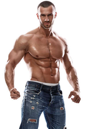 Handsome muscular man posing in studio Standard-Bild
