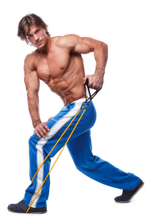 latissimus: Handsome guy working out with rubber band over white background
