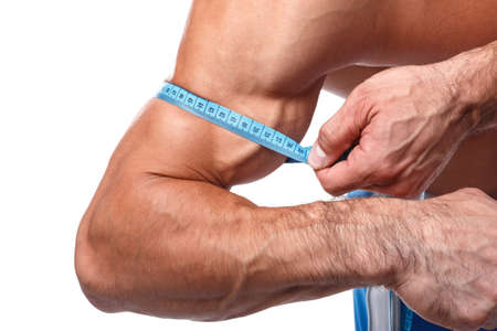 his: Muscular man measuring his biceps Stock Photo