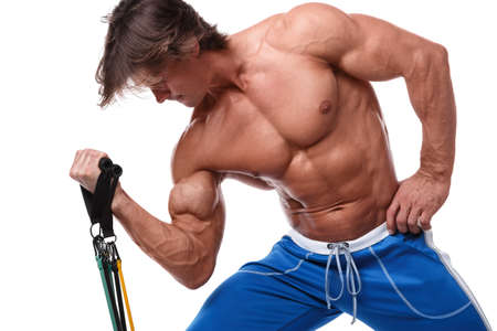 Handsome guy working out with rubber band over white background