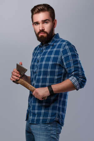 robust: Portrait of handsome bearded man in checkered shirt