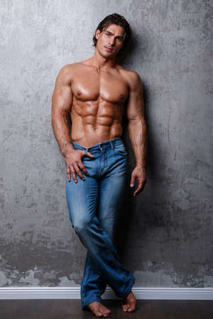 Handsome muscle man in jeans