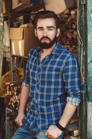 Handsome bearded man in checkered shirt Banco de Imagens