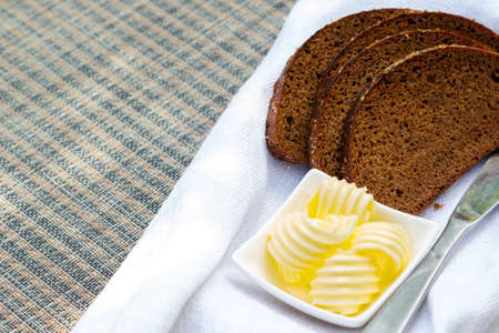 Slices of bread and butter on the table