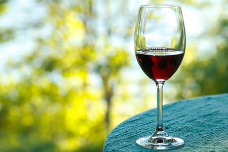 Glass of wine on the table with a bokeh on the background