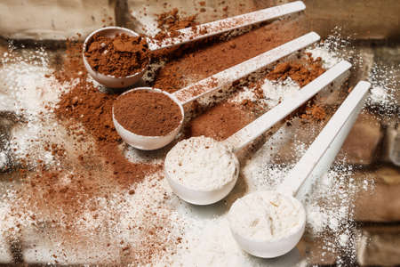 albumin: Scoops with protein powder on the table