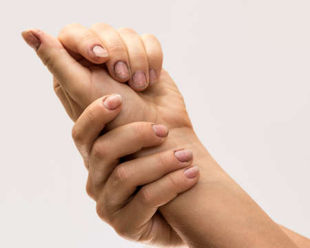 penury: Female hands with dirty nails in studio Stock Photo