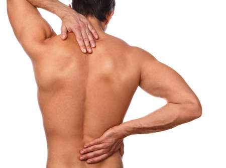 Man with pain in his back over white background Standard-Bild