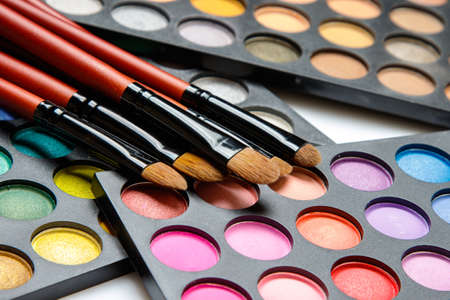 Close up of professional makeup brushes and eyeshadow palette Stock Photo