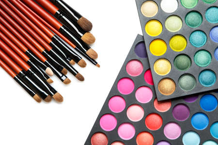 eyemakeup: Professional makeup brushes and eyeshadow palette on white background