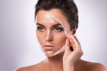 Young and beautiful woman with Purifying Mask on her face