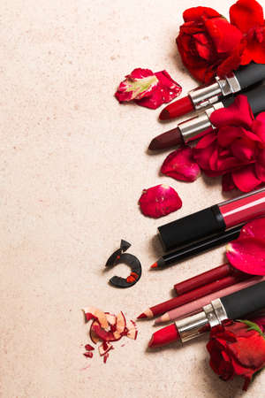 Red lipstick and rose flowers Stock Photo