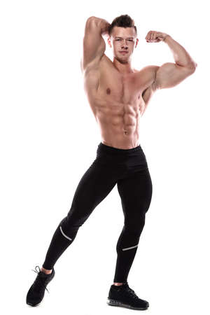 Young bodybuilder showing his muscles in studio