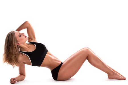 laying abs exercise: Sexy fitness girl posing in studio
