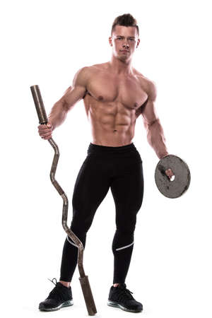Young bodybuilder with barbell on white background Stock Photo