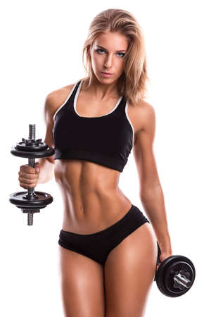 Beautiful and sexy fitness girl with dumbbells Banco de Imagens - 85172865