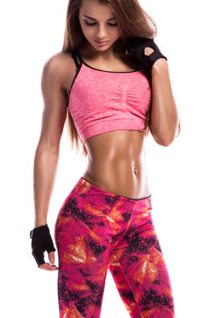 Beautiful fitness girl in studio