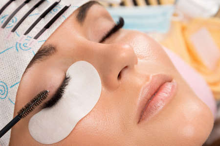 Procedure of eyelashes extension in salon