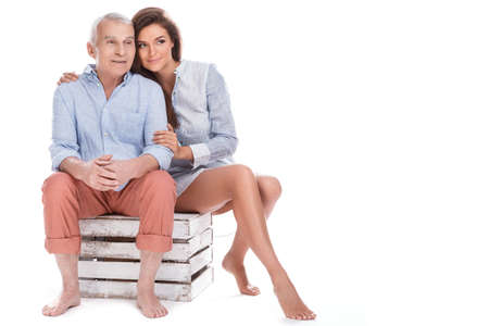 Beautiful woman and her eldery father on white background